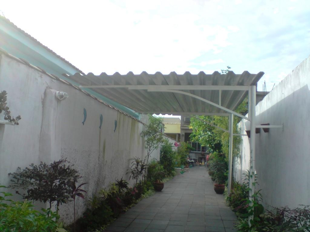 Cobertura abrigo de carro prosol toldos for Tipos de toldos para patios